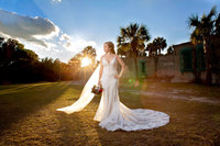 bridal portrait against the sun at Atalaya Castle