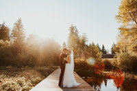 Gorgeous couple at golden hour on the docks at Black Diamond Gardens Wedding Venue by Sarah Anne Photo