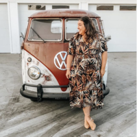 volkswagen bus with girl in floral dress