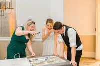 Bride and groom reacting to their live wedding painting in Norfolk Virginia at the Hilton on Main
