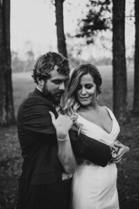 J.Michelle Photography is an Atlanta, Ga photographer who  photographs a couple embracing before their North Georgia wedding ceremony