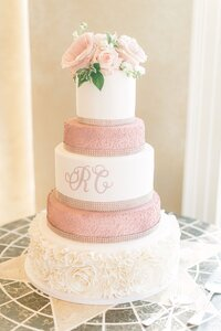 custom wedding cake with pink flowers on top