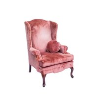 Pale pink velvet tufted arm chair with Queen Anne legs.