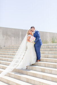 Bride and groom up the arizona science center steps in downtown phoenix arizona