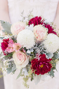 A bridal bouquet featuring roses and dahlias for a vintage inspired sacramento wedding.