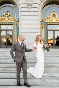 Bride and groom getting married at San Francisco City Hall. Wedding photo taken by Cheers Babe Photo.