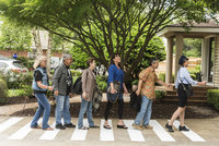 Guests pose on Abbey Road for a Beatles themed Birthday Party