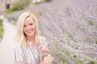 Girl holds lavender and smiles.