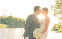 Groom and Bride kiss with the sun directly behind them in this Southern Ontario Wedding