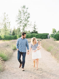 jake and anna tenney walking along a road at monet vineyards