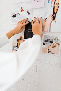 Woman's hands on mood board