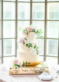 Simple, white and pink wedding cake