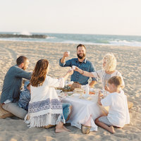 A family hosts dinner on the beach in Oxnard, California