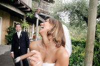 Bride and groom with a cigar at Auberge du Soleil in Napa