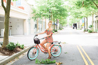 woman on bike posing outside