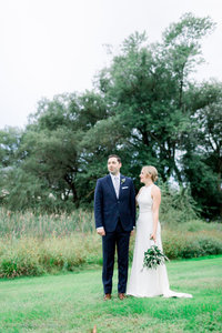 Outdoor wedding couple poses at Highlands Country  Club in Garrison NY