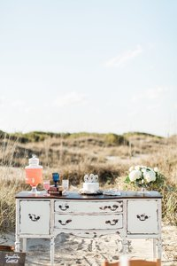 A decorated buffet in the sand dunes.