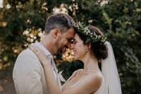 Couple embracing on their wedding day taken by Asheville wedding photographers.