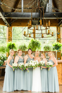Bridesmaids in muted taupe dresses at a Gervasi Vineyard wedding photographed by akron ohio wedding photographer