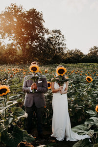 couple holding sunflowers