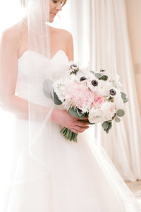 detail photo of a bride holding her bouquet.