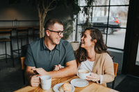 engaged couple having fun at a coffee shop