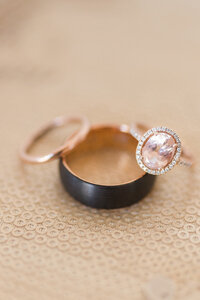 a set of rose gold morganite wedding rings placed on a sequin pillow case at a downtown sacramento wedding