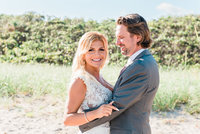 A Palm beach wedding couple after their intimate beach ceremony
