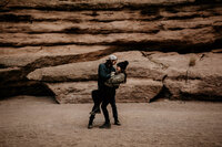 husband holding wife in a New Mexico canyon