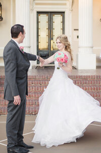 A groom twirls his bride at their Grand Island Mansion Wedding.