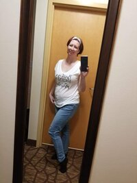 Savannah birth photographer Crystal McClurg  taking a selfie to show off her new birth shirt
