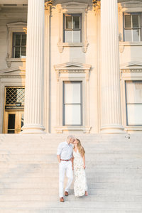 Couple kissing on steps of San Francisco City Hall