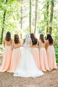 Bridesmaids in peach dresses