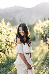 Portrait of bride in the vineyard during sunset engagement session at Beecher Hill House