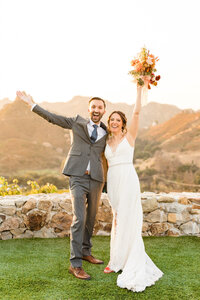 Bride and groom celebrating their wedding at Cielo Farms in Malibu, California. Photo taken by Cheers Babe Photo.