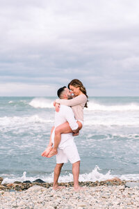 Montauk engagement photo on the beach captured by Hamptons wedding photographer Myra Roman