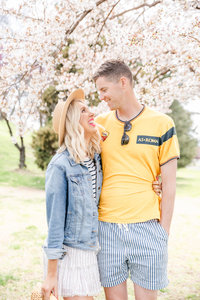 Lifestyle brand photos of couple with cherry blossom tree