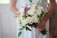 bride holding flowers | Jennifer Pellin
