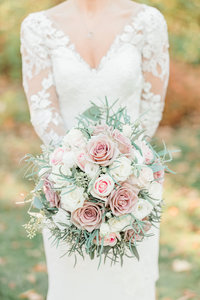 Light and Detail photo showing  a bridal bouquet of pink and white roses.