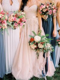Big bridal bouquet for boho wedding with blush dress