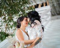woman-in-white-floral-dress-kissing-woman-in-white-dress-3818650