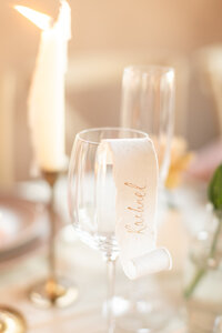 Calligraphy place cards in European inspired wedding decor captured by NJ wedding videography and photography team Diana & Korey Photo and Film