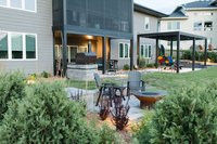 Waukee, Iowa back yard landscape with pergola, patio, fire pit and outdoor kitchen