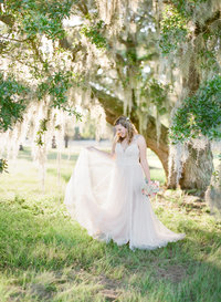 bridal portraits under the glowing oaks in south carolina