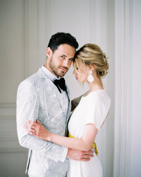 Young couple embraces during their French Chateau elopement