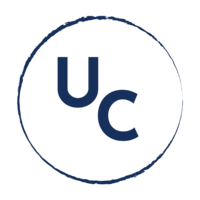 A dark blue circular monogram submark for Upstream Consulting.