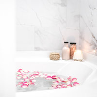 Charlotte Wedding Photographer | Heather Yvonne | bubble bath with candles lit and flower petals
