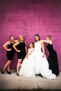 Bride and bridesmaids posing against purple wall St Louis Pinxit Photo