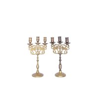 Collection of brass candlesticks.