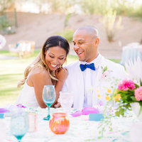bride and groom portrait laughing at head table